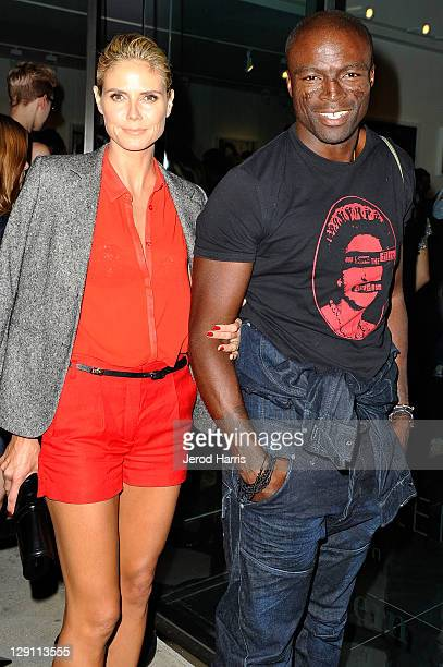 Heidi Klum and Seal arrive at the private viewing for Rankin and Damien Hirst's new gallery show on October 12 2011 in Los Angeles California