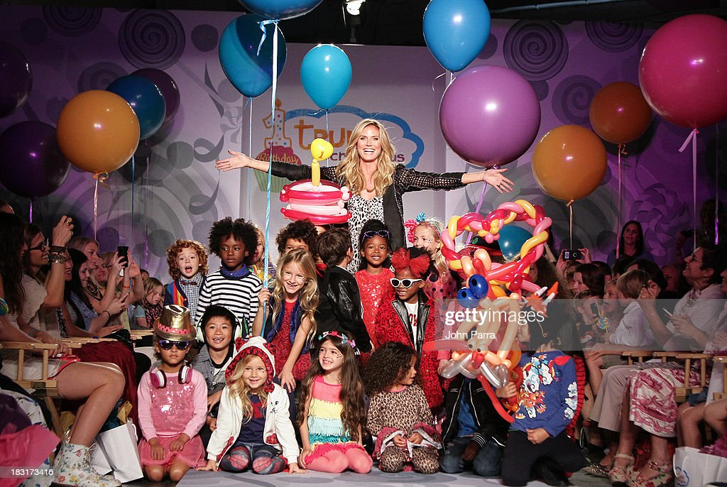 Heidi Klum (C) and the models walk the runway at the Truly Scrumptious for Babies 'R' Us designed by Heidi Klum at Vogue Bambini petiteParade Kids Fashion Week on October 5, 2013 in New York City.
