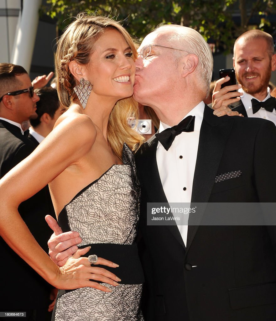 <a gi-track='captionPersonalityLinkClicked' href=/galleries/search?phrase=Heidi+Klum&family=editorial&specificpeople=178954 ng-click='$event.stopPropagation()'>Heidi Klum</a> and <a gi-track='captionPersonalityLinkClicked' href=/galleries/search?phrase=Tim+Gunn&family=editorial&specificpeople=696109 ng-click='$event.stopPropagation()'>Tim Gunn</a> attend the 2013 Creative Arts Emmy Awards at Nokia Theatre L.A. Live on September 15, 2013 in Los Angeles, California.