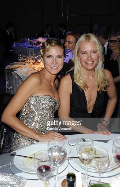 Heidi Klum and Valeria Mazza attend amfAR Milano 2010 Dinner during Milan Fashion Week Womenswear Spring/Summer 2011 at La Permanente on September 27...