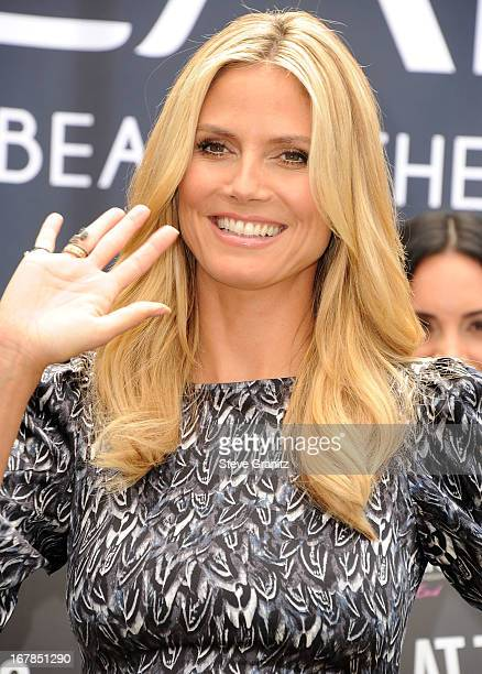 Heidi Klum appears at The Grove in Los Angeles to lead the 'Right End' Hair Revolution a movement sparked by Clear Scalp Hair Beauty Therapy on May 1...