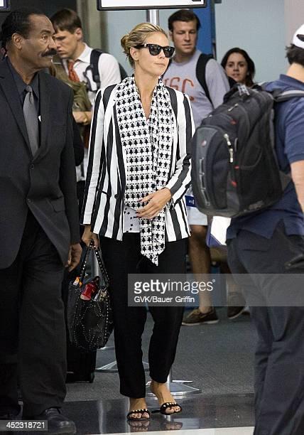Heidi Klum arrives at Los Angeles International Airport on August 29 2013 in Los Angeles California