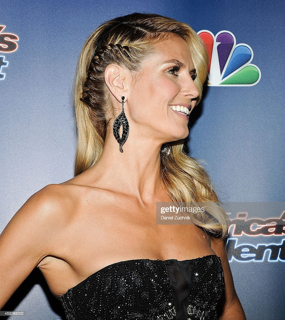 <a gi-track='captionPersonalityLinkClicked' href=/galleries/search?phrase=Heidi+Klum&family=editorial&specificpeople=178954 ng-click='$event.stopPropagation()'>Heidi Klum</a>(hair/earrings detail) attends 'America's Got Talent' season 9 post show red carpet event at Radio City Music Hall on August 6, 2014 in New York City.