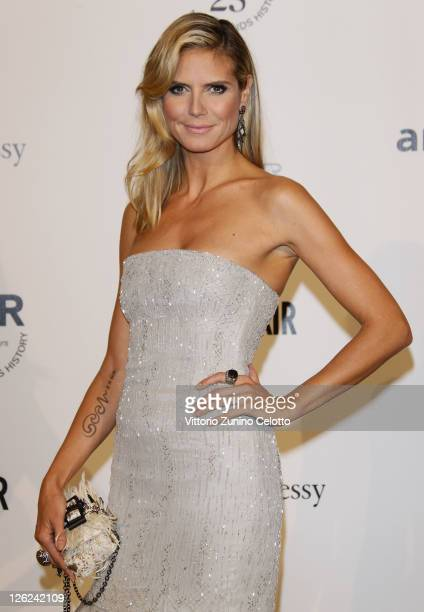 Heidi Klum attends amfAR MILANO 2011 at La Permanente on September 23 2011 in Milan Italy