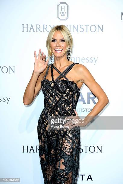 Heidi Klum attends amfAR Milano 2015 at La Permanente on September 26 2015 in Milan Italy