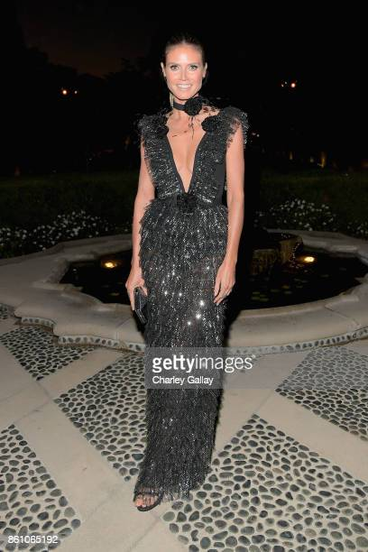 Heidi Klum attends the amfAR Gala Los Angeles 2017 at Ron Burkle's Green Acres Estate on October 13 2017 in Beverly Hills California
