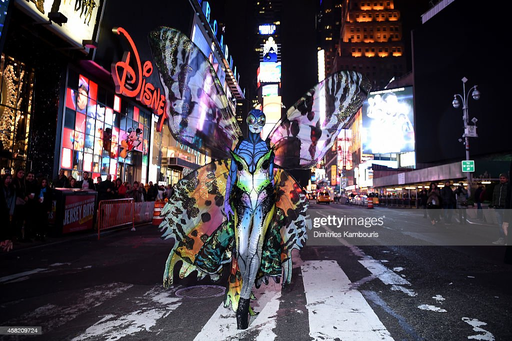<a gi-track='captionPersonalityLinkClicked' href=/galleries/search?phrase=Heidi+Klum&family=editorial&specificpeople=178954 ng-click='$event.stopPropagation()'>Heidi Klum</a> gives Times Square visitors a sneak peek of her Halloween costume before hosting her annual party at TAO Downtown sponsored Bby Moto X on October 31, 2014 in New York City.