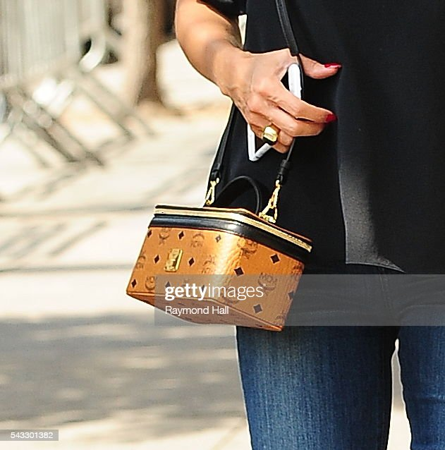 <a gi-track='captionPersonalityLinkClicked' href=/galleries/search?phrase=Heidi+Klum&family=editorial&specificpeople=178954 ng-click='$event.stopPropagation()'>Heidi Klum</a>, handbag detail, is seen looking at a new apartment in Soho on June 27, 2016 in New York City.
