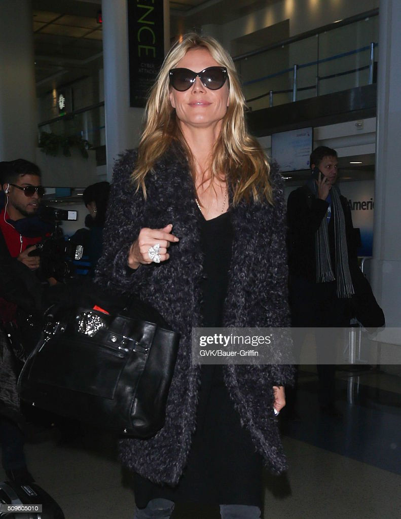 <a gi-track='captionPersonalityLinkClicked' href=/galleries/search?phrase=Heidi+Klum&family=editorial&specificpeople=178954 ng-click='$event.stopPropagation()'>Heidi Klum</a> is seen at LAX on February 11, 2016 in Los Angeles, California.