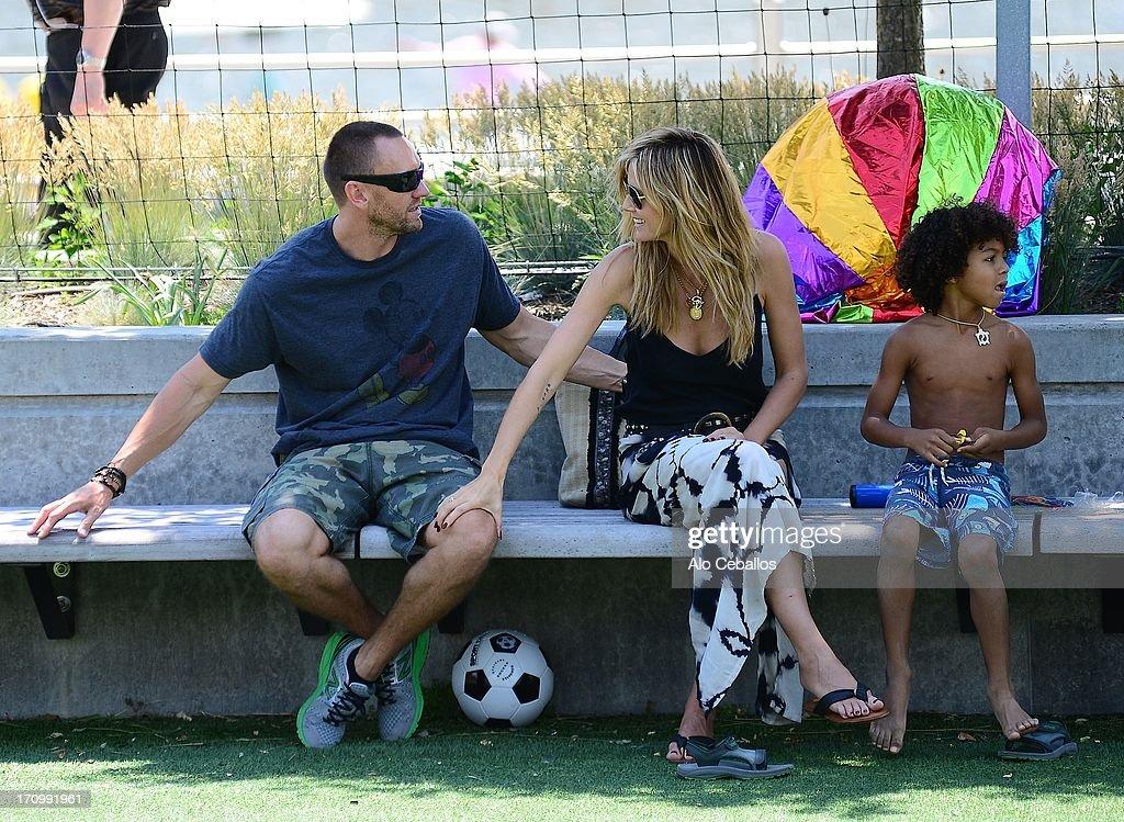 Heidi Klum, Johan Riley Fyodor Taiwo Samuel and and Martin Kristen are seen in Tribeca Husdon River Park on June 20, 2013 in New York City.