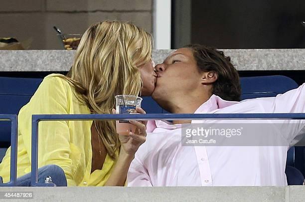 Heidi Klum kisses her boyfriend Vito Schnabel on Day 8 of the 2014 US Open at USTA Billie Jean King National Tennis Center on September 1 2014 in the...