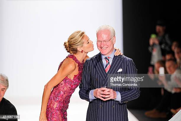 Heidi Klum kisses Tim Gunn after ALS Ice Bucket Challenge at Project Runway during MercedesBenz Fashion Week Spring 2015 at The Theatre at Lincoln...