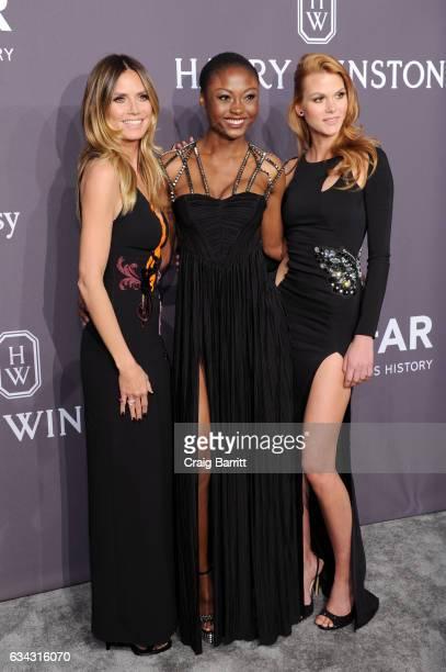 Heidi Klum Lynn Petertonkoker and Leticia WalaNtuba attend the amfAR New York Gala 2017 sponsored by FIJI Water at Cipriani Wall Street on February 8...