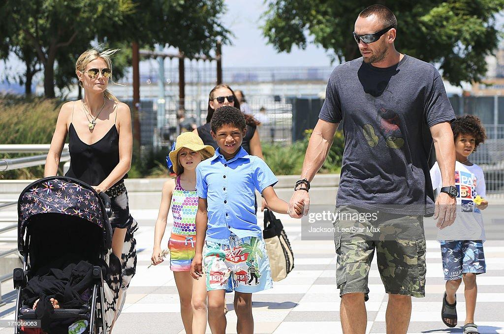 Heidi Klum, Martin Kristen, Helene Boshoven Samuel, Henry Samuel, Johan Samuel and Lou Sulola Samuel are seen on June 20, 2013 in New York City.