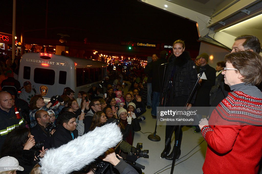 Heidi Klum participates in a tree lighting ceremony as she teams up with friends at AOL, Patch and The American Red Cross to benefit Hurricane Sandy relief efforts at American Red Cross and Patch Sites on December 2, 2012 in Lindenhurst, New York.