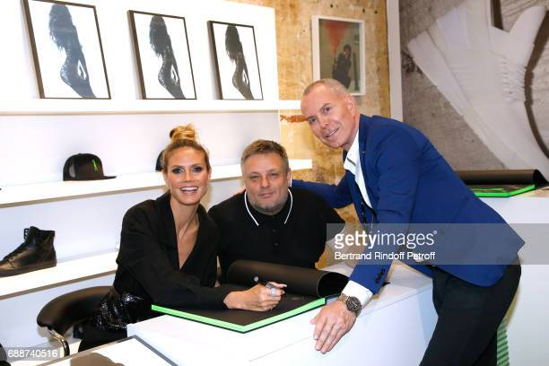 Heidi Klum photographer John Rankin Waddell aka Rankin and stylist JeanClaude Jitrois attend 'Heidi Klum by Rankin' Heidi Klum Rankin launch book at...