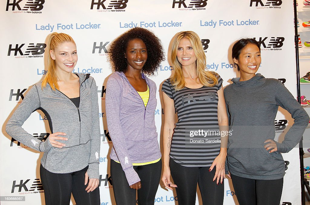 Heidi Klum (2nd R) poses with (L-R) models Sarah Otey, Porsche Thomas and Jennifer An at the launch of her new Heidi Klum for New Balance Collection at Lady Foot Locker on March 14, 2013 in Culver City, California.