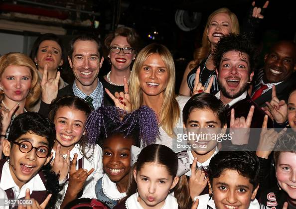 Heidi Klum poses with the cast backstage at 'School of Rock the Musical' on Broadway at The Winter Garden Theatre on June 29 2016 in New York City