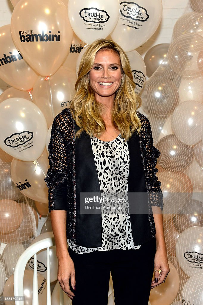 <a gi-track='captionPersonalityLinkClicked' href=/galleries/search?phrase=Heidi+Klum&family=editorial&specificpeople=178954 ng-click='$event.stopPropagation()'>Heidi Klum</a> presents her holiday Truly Scrumptious collection for Babies'R'Us at Kids Fashion Week on October 5, 2013 in New York City.
