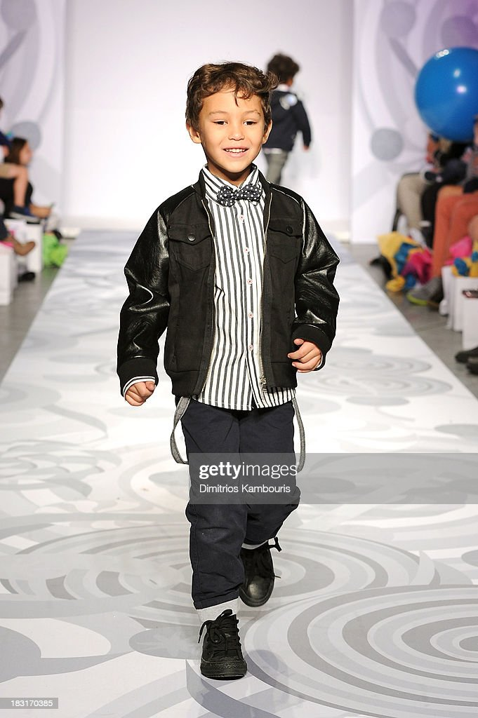 Heidi Klum presents her holiday Truly Scrumptious collection for Babies'R'Us at Kids Fashion Week on October 5, 2013 in New York City.