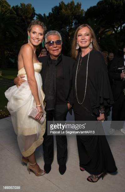 Heidi Klum Roberto Cavalli and Eva Cavalli attend amfAR's 20th Annual Cinema Against AIDS during The 66th Annual Cannes Film Festival at Hotel du...