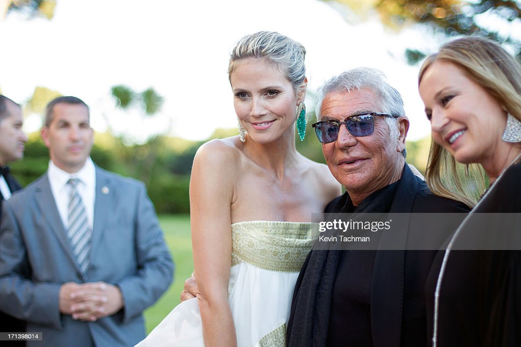 (L-R) Heidi Klum, Roberto Cavalli and Eva Cavalli attend at the cocktail party for amfAR's 20th Annual Cinema Against AIDS at Hotel du Cap-Eden-Roc on May 23,2013 in Cap d'Antibes, France.