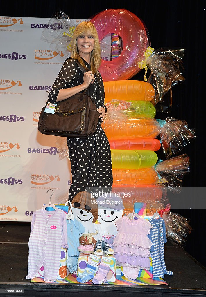 Heidi Klum speaks onstage at Operation Shower sponsored by Babies'R'Us event hosted by Heidi Klum at The Globe Theatre at Universal Studios on March...