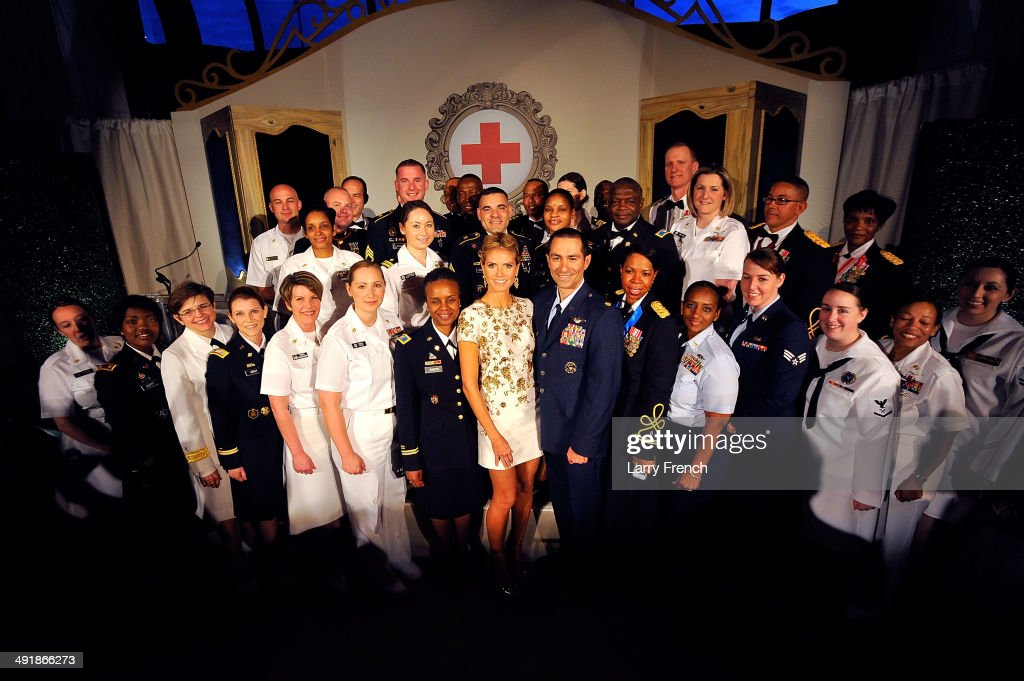 <a gi-track='captionPersonalityLinkClicked' href=/galleries/search?phrase=Heidi+Klum&family=editorial&specificpeople=178954 ng-click='$event.stopPropagation()'>Heidi Klum</a> (C)stands with members of the military before being honored with the American Red Cross Crystal Cross Award for 10 years of service with the organization at the Tiffany Circle Women's Leadership Summit at the French Embassy on May 17, 2014 in Washington, DC.