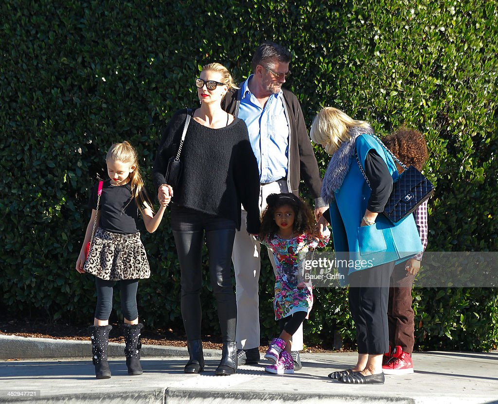 Heidi Klum with daughters, Leni Klum (R) and Lou Klum with mother, Erna Klum and father, Gunther Klum are seen on December 01, 2013 in Los Angeles, California.
