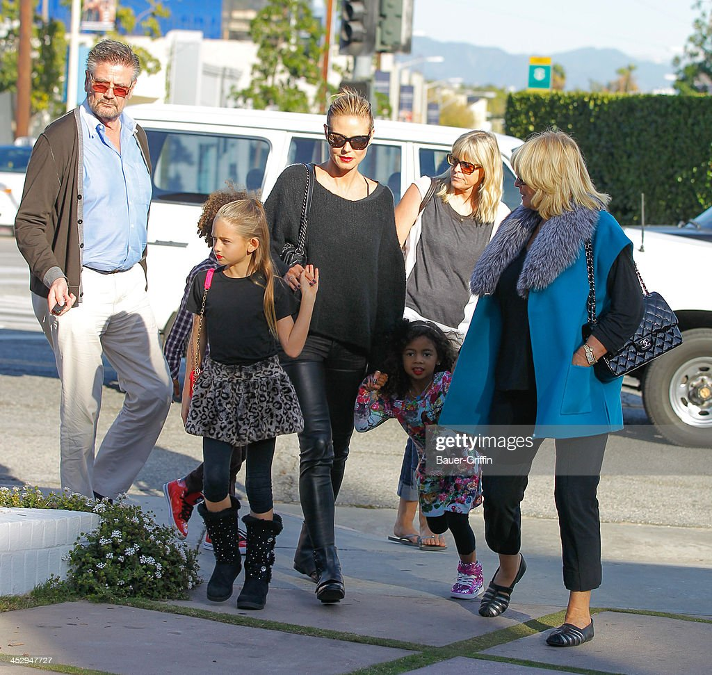 Heidi Klum with daughters, Leni Klum and Lou Klum with mother, Erna Klum (R) and father Gunther Klum (L) are seen on December 01, 2013 in Los Angeles, California.