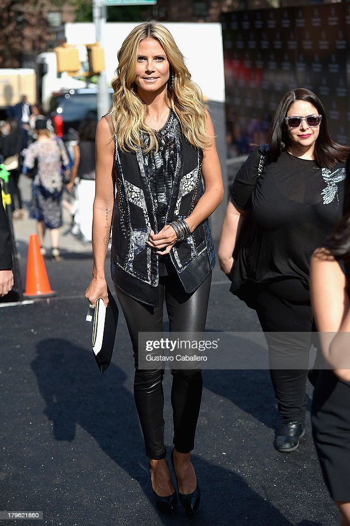 <a gi-track='captionPersonalityLinkClicked' href=/galleries/search?phrase=Heidi+Klum&family=editorial&specificpeople=178954 ng-click='$event.stopPropagation()'>Heidi Klum</a>s is seen around Lincoln Center - Day 1 - Mercedes-Benz Fashion Week Spring 2014 at Lincoln Center for the Performing Arts on September 5, 2013 in New York City.