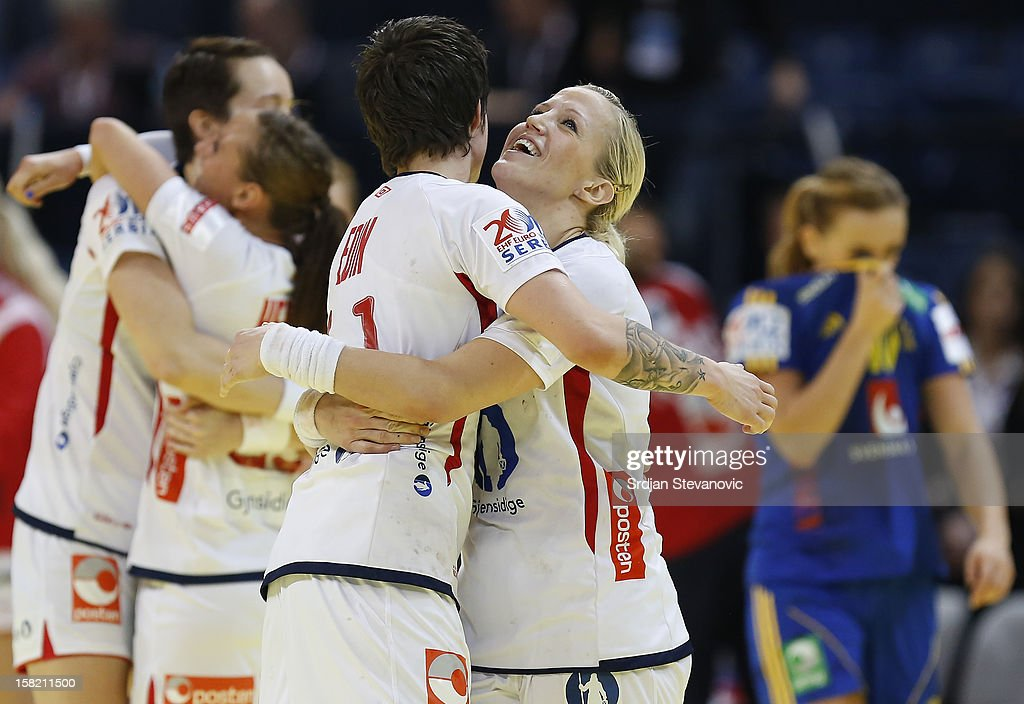 Heidi Loke (R) and Anja Edin (L) of Norway celebrate victory over Sweden after the Women's European Handball Championship 2012 Group I main round match between Norway and Sweden at Arena Hall on December 11, 2012 in Belgrade, Serbia.