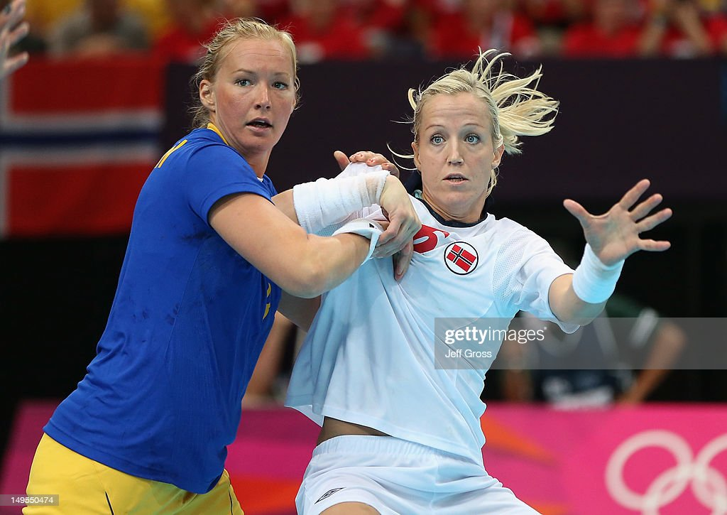 <a gi-track='captionPersonalityLinkClicked' href=/galleries/search?phrase=Heidi+Loke&family=editorial&specificpeople=6331820 ng-click='$event.stopPropagation()'>Heidi Loke</a> of Norway and Kristina Flognman of Sweden tangle during the Women's Handball Preliminaries Group B - Match 12 between Sweden and Norway on Day 3 of the London 2012 Olympic Games at the Copper Box on July 30, 2012 in London, England.