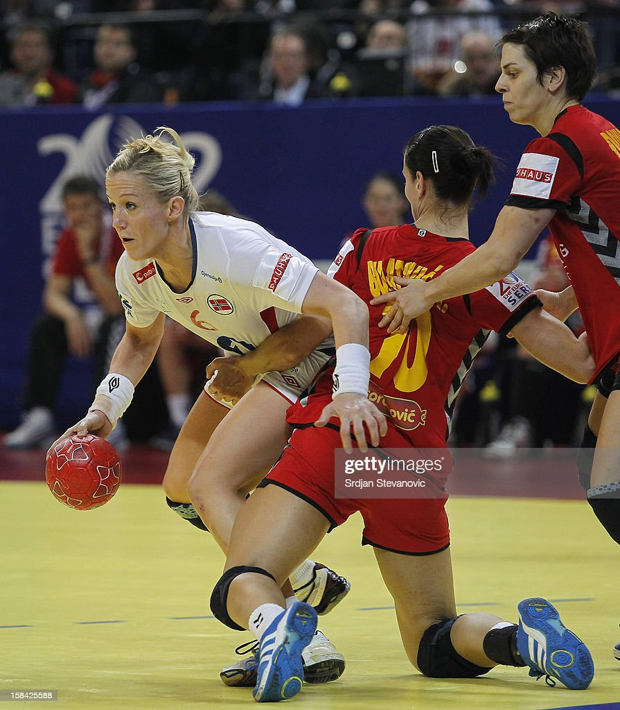 Heidi Loke (L) of Norway is challenged by Andjela Bulatovic of Montenegro (R) during the Women's European Handball Championship 2012 gold medal match between Norway and Montenegro at Arena Hall on December 16, 2012 in Belgrade, Serbia.