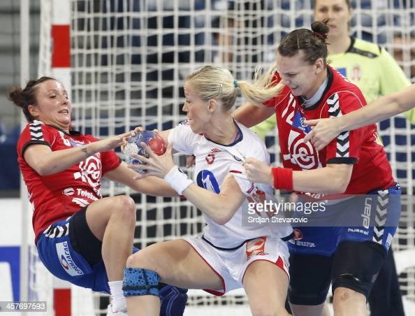 Heidi Loke of Norway is challenged by Katarina Krpez and Dragana Cvijic of Serbia during the 2013 World Women's Handball Championship 2013 match...