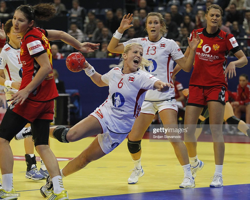 Heidi Loke (R) of Norway jump to scores past Milena Knezevic of Montenegro (L) during the Women's European Handball Championship 2012 gold medal match between Norway and Montenegro at Arena Hall on December 16, 2012 in Belgrade, Serbia.