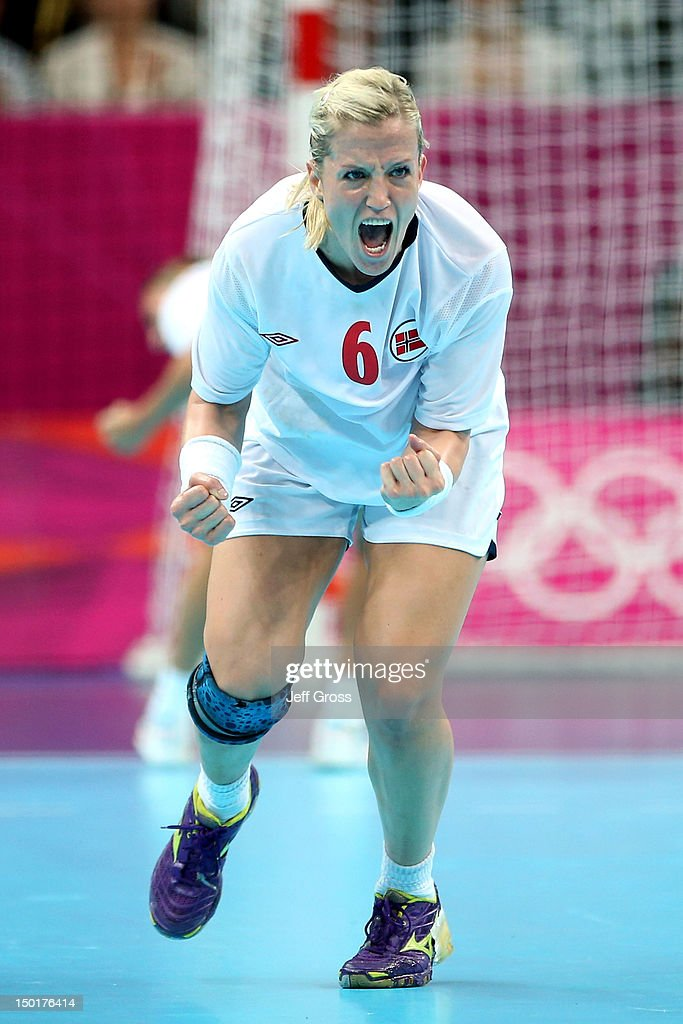 <a gi-track='captionPersonalityLinkClicked' href=/galleries/search?phrase=Heidi+Loke&family=editorial&specificpeople=6331820 ng-click='$event.stopPropagation()'>Heidi Loke</a> #6 of Norway reacts after a point against Montenegro during the Women's Handball Gold Medall Match on Day 15 of the London 2012 Olympics Games at Basketball Arena on August 11, 2012 in London, England.