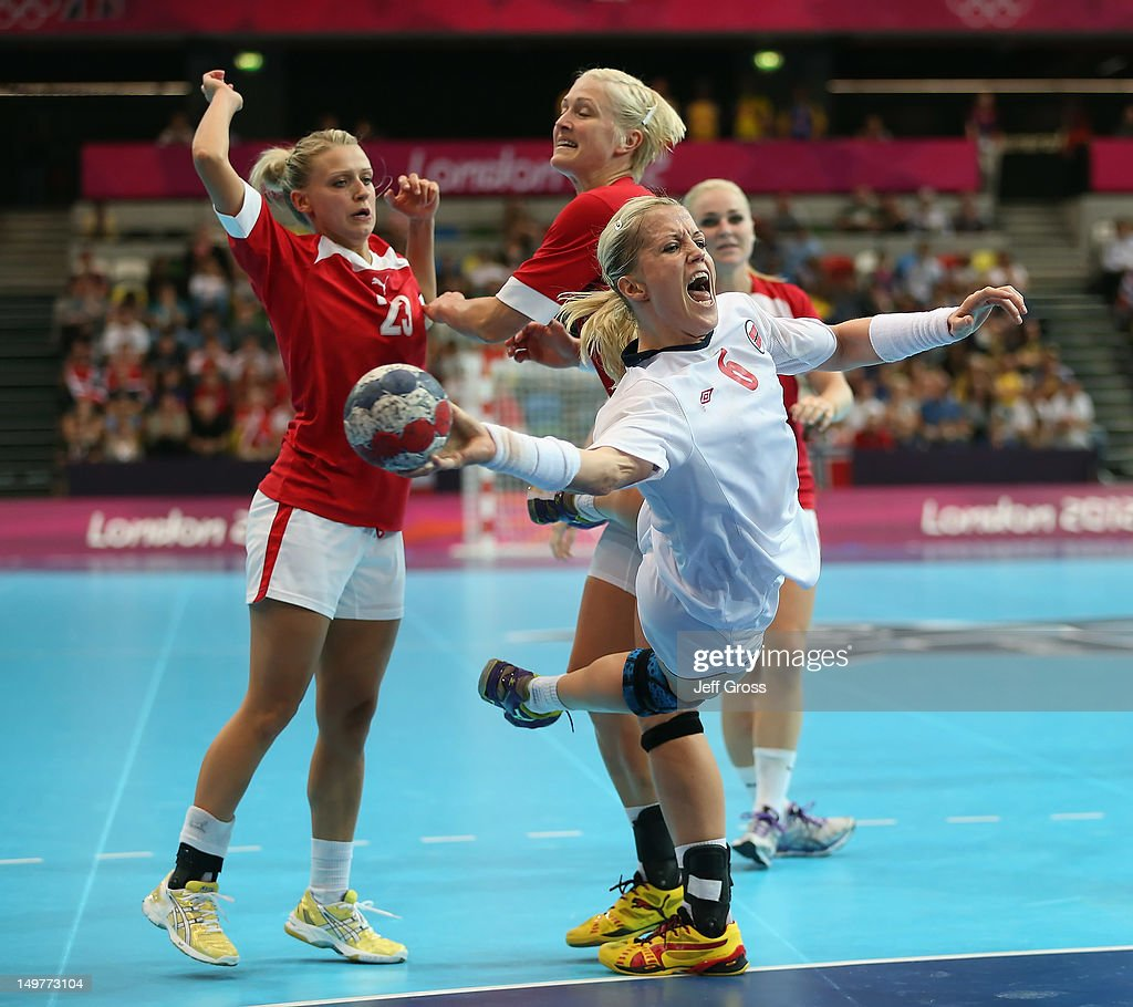 <a gi-track='captionPersonalityLinkClicked' href=/galleries/search?phrase=Heidi+Loke&family=editorial&specificpeople=6331820 ng-click='$event.stopPropagation()'>Heidi Loke</a> #6 of Norway shoots past Ann Grete Norgaard (L) #23 and Rikke Skov #25 of Denmark during the Women's Handball Preliminaries Group A match between Norway and Denmark on Day 7 of the London 2012 Olympic Games at Copper Box on August 3, 2012 in London, England.