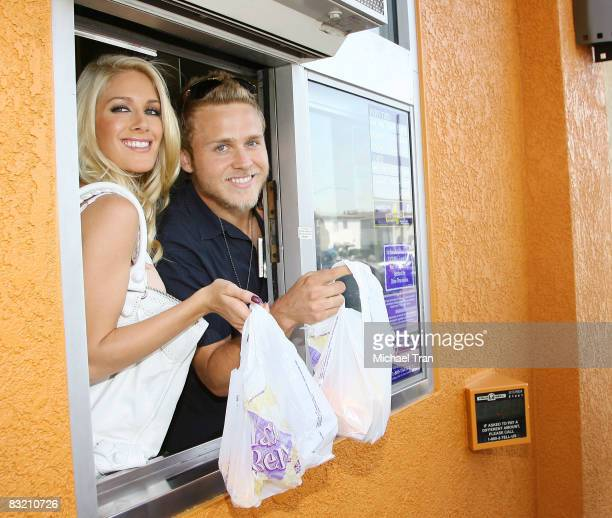 Heidi Montag and Spencer Pratt serve customers at the driveup window to the 'Reality Check Challenge' held at Taco Bell on October 2 2008 in Los...