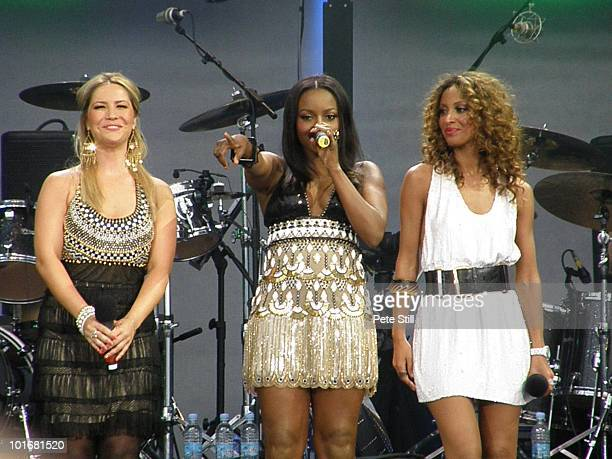 Heidi Range Keisha Buchanan and Amelle Berrabah of the Sugababes perform on stage at the 46664 concert in honour of Nelson Mandela's 90th birthday in...