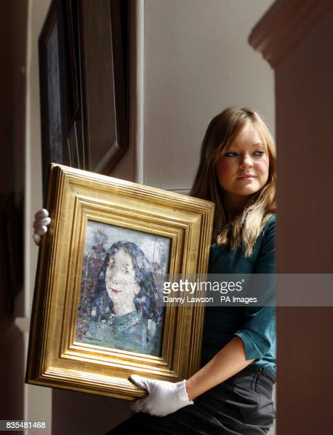 Heidi Squirrell from Lyon Turnbull holds a rare painting by artist John Pringle estimated to sell for between 35000 and 45000 at the Lyon Turnbull...