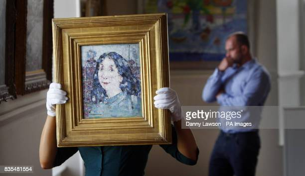 PHOTO Heidi Squirrell from Lyon Turnbull holds a rare painting by artist John Pringle estimated to sell for between 35000 and 45000 at the Lyon...