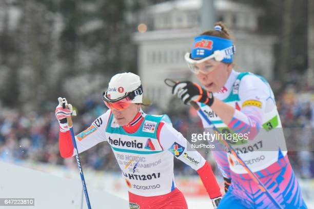 Heidi Weng from Norway next to Kerttu Niskanen from Finland in action during Ladies crosscountry 4 x 50km Relay Classic/Free final at FIS Nordic...