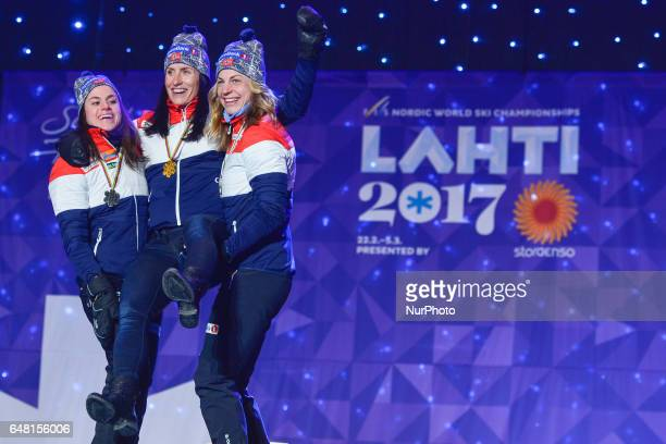 Heidi Weng Marit Bjoergen and Astrid Uhrenholdt Jacobsen all from Norway at the Award Ceremony of Ladies crosscountry 30 km Mass Start Free final at...