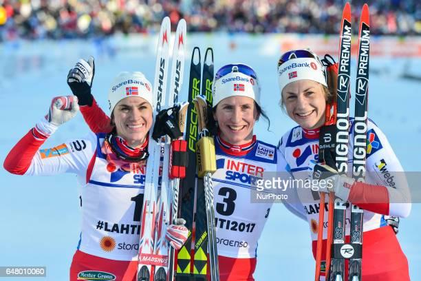 Heidi Weng Marit Bjoergen and Astrid Uhrenholdt Jacobsen the podium of Ladies crosscountry 30 km Mass Start Free final at FIS Nordic World Ski...