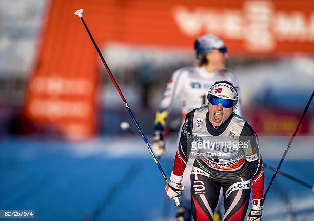 Heidi Weng of Norway celebrates victory after the women's Sprint C race on December 2 2016 in Lillehammer Norway