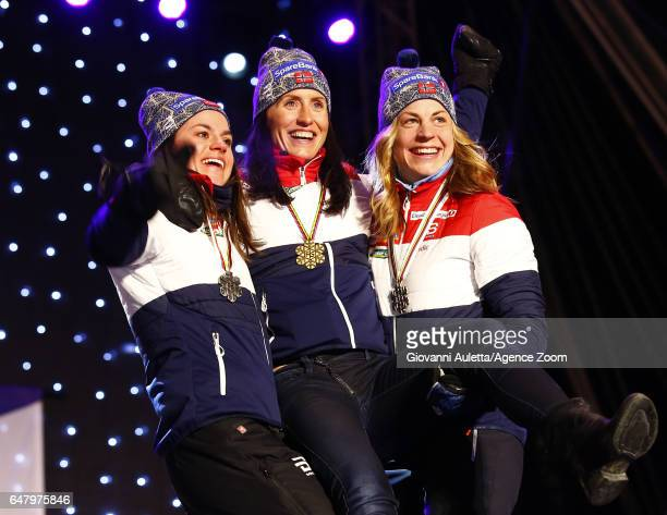 Heidi Weng of Norway wins the silver medal Marit Bjoergen of Norway wins the gold medal Astrid Uhrenholdt Jacobsen of Norway wins the bronze medal...