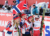 Heidi Weng Therese Johaug Astrid Uhrenholdt Jacobsen and Marit Bjoergen of Norway celebrate winning the gold medal in the Women's 4 x 5km...