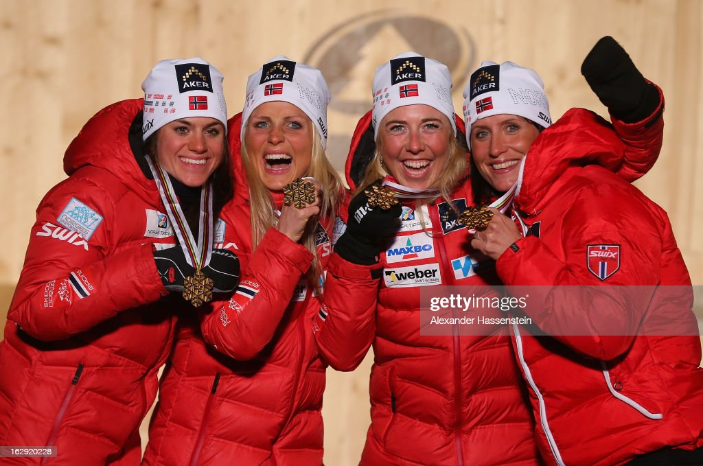 Heidi Weng, Therese Johaug, Kristin Steira and Marit Bjoergen of Norway celebrate victory with their Gold medals during the Medal Ceremony for the Cross Country Women's Relay at the FIS Nordic World Ski Championships on March 1, 2013 in Val di Fiemme, Italy.