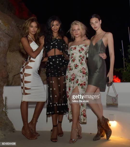 Heidy De La Rosa Chanel Iman Lottie Moss Vittoria Ceretti pose for a photo during the Velocity Black party on July 29 2017 in Mykonos Greece